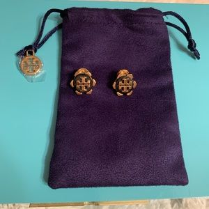 Black and gold Tory Burch earrings.